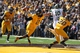 Oct 19, 2013; Laramie, WY, USA; Wyoming Cowboys safety Marqueston Huff (2) breaks up a pass and makes an interception with teammate Blair Burns (20)against Colorado State Rams tight end Crockett Gillmore (10) during the first quarter at War Memorial Stadium. Mandatory Credit: Troy Babbitt-USA TODAY Sports