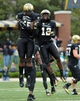 Oct 19, 2013; Nashville, TN, USA; Vanderbilt Commodores cornerback Steven Clarke (12) and defensive end Caleb Azubike (55) celebrate after the Commodores recovered a Georgia Bulldogs fumble late in the second half at Vanderbilt Stadium. The Commodores beat the Bulldogs 31-27. Mandatory Credit: Don McPeak-USA TODAY Sports