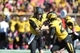 Oct 19, 2013; Columbia, MO, USA; Missouri Tigers quarterback Maty Mauk (7) hands off to running back Henry Josey (20) during the second half of the game against the Florida Gators at Faurot Field. Missouri won 36-17. Mandatory Credit: Denny Medley-USA TODAY Sports