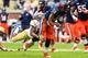 Oct 19, 2013; Atlanta, GA, USA; Syracuse Orange quarterback Terrel Hunt (10) is tackled by Georgia Tech Yellow Jackets safety Isaiah Johnson (1) in the first half at Bobby Dodd Stadium. Mandatory Credit: Daniel Shirey-USA TODAY Sports