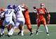 Oct 19, 2013; Stillwater, OK, USA; Oklahoma State Cowboys Clint Chelf (10) throws a pass down field against the Texas Christian Horned Frogs during the first half at Boone Pickens Stadium. Oklahoma State won 24-10. Mandatory Credit: Peter G. Aiken-USA TODAY Sports