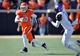 Oct 19, 2013; Stillwater, OK, USA; Oklahoma State Cowboys quarterback Clint Chelf (10) rushes up field against Texas Christian Horned Frogs safety Chris Hackett (1) during the second half at Boone Pickens Stadium. Oklahoma State won 24-10. Mandatory Credit: Peter G. Aiken-USA TODAY Sports