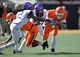 Oct 19, 2013; Stillwater, OK, USA; Oklahoma State Cowboys quarterback Clint Chelf (10) rushes up field against Texas Christian Horned Frogs defensive back Jason Verrett (2) during the second half at Boone Pickens Stadium. Oklahoma State won 24-10. Mandatory Credit: Peter G. Aiken-USA TODAY Sports