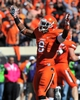 Oct 19, 2013; Stillwater, OK, USA; Oklahoma State Cowboys safety Daytawion Lowe (8) reacts after the Cowboys recovered a Texas Christian Horned Frogs fumble during the first half at Boone Pickens Stadium. Oklahoma State won 24-10. Mandatory Credit: Peter G. Aiken-USA TODAY Sports