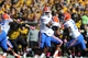 Oct 19, 2013; Columbia, MO, USA; Florida Gators quarterback Tyler Murphy (3) hands off to running back Kelvin Taylor (21) during the second half of the game against the Missouri Tigers at Faurot Field. Missouri won 36-17. Mandatory Credit: Denny Medley-USA TODAY Sports