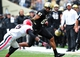 Oct 19, 2013; Nashville, TN, USA; Vanderbilt Commodores wide receiver Jordan Matthews (87) carries the ball against Georgia Bulldogs cornerback Damian Swann (5) during the first half at Vanderbilt Stadium. The Commodores beat the Bulldogs 31-27. Mandatory Credit: Don McPeak-USA TODAY Sports