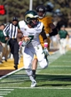 Oct 19, 2013; Laramie, WY, USA; Colorado State Rams running back Donnell Alexander (7) makes a catch and runs for a touchdown in front of Wyoming Cowboys linebacker Lucas Wacha (45) during the third quarter at War Memorial Stadium.  The Rams defeated the Cowboys 52-22.   Mandatory Credit: Troy Babbitt-USA TODAY Sports