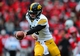 Oct 19, 2013; Columbus, OH, USA; Iowa Hawkeyes quarterback Jake Rudock (15) hands the ball off during the third quarter against the Ohio State Buckeyes at Ohio Stadium. Mandatory Credit: Andrew Weber-USA TODAY Sports