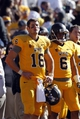 Oct 19, 2013; Laramie, WY, USA; Wyoming Cowboys quarterback Brett Smith (16) and wide receiver Robert Herron (6) watch the final minutes during the game with the Colorado State Rams at War Memorial Stadium. The Rams defeated the Cowboys 52-22.   Mandatory Credit: Troy Babbitt-USA TODAY Sports