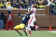 Oct 19, 2013; Ann Arbor, MI, USA; Indiana Hoosiers wide receiver Kofi Hughes (13) makes a touchdown catch over Michigan Wolverines defensive back Channing Stribling (8) in the third quarter at Michigan Stadium. Mandatory Credit: Rick Osentoski-USA TODAY Sports