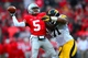 Oct 19, 2013; Columbus, OH, USA; Ohio State Buckeyes quarterback Braxton Miller (5) is pressed by Iowa Hawkeyes offensive linesman Richard Pryor (71) during the fourth quarter against the at Ohio Stadium. Mandatory Credit: Andrew Weber-USA TODAY Sports