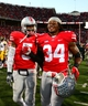 Oct 19, 2013; Columbus, OH, USA; Ohio State Buckeyes quarterback Braxton Miller (5) and defensive end Jamal Marcus (34) celebrate after defeating Iowa Hawkeyes 34-24 at Ohio Stadium. Mandatory Credit: Andrew Weber-USA TODAY Sports