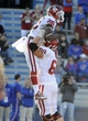 Oct 19, 2013; Lawrence, KS, USA; Oklahoma Sooners running back Damien Williams (26) celebrates with offensive linesman Bronson Irwin (68) after scoring a touchdown against the Kansas Jayhawks in the second half at Memorial Stadium. Oklahoma won the game 34-19. Mandatory Credit: John Rieger-USA TODAY Sports