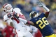Oct 19, 2013; Ann Arbor, MI, USA; Indiana Hoosiers wide receiver Nick Stoner (14) makes a catch over Michigan Wolverines defensive back Jourdan Lewis (26) in the second half at Michigan Stadium. Michigan won 63-47. Mandatory Credit: Rick Osentoski-USA TODAY Sports