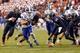 Oct 19, 2013; Charlottesville, VA, USA;  Duke Blue Devils quarterback Brandon Connette (18) runs with the ball to score a touchdown past Virginia Cavaliers linebacker Henry Coley (44) in the third quarter at Scott Stadium. The Blue Devils won 35-22. Mandatory Credit: Geoff Burke-USA TODAY Sports