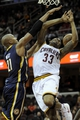 Oct 19, 2013; Cleveland, OH, USA; Indiana Pacers forward David West (21) fouls Cleveland Cavaliers guard Alonzo Gee (33) during the first quarter at Quicken Loans Arena. Mandatory Credit: Ken Blaze-USA TODAY Sports