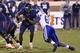 Oct 19, 2013; Charlottesville, VA, USA;  Virginia Cavaliers quarterback David Watford (5) is tackled by Duke Blue Devils defensive end Kenny Anunike (84) in the fourth quarter at Scott Stadium. The Blue Devils won 35-22. Mandatory Credit: Geoff Burke-USA TODAY Sports