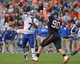 Oct 19, 2013; Charlottesville, VA, USA;  Duke Blue Devils quarterback Anthony Boone (7) throws the ball as Virginia Cavaliers defensive end Jake Snyder (90) chases in the fourth quarter at Scott Stadium. The Blue Devils won 35-22. Mandatory Credit: Geoff Burke-USA TODAY Sports