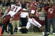 Oct 19, 2013; Tuscaloosa, AL, USA;  Alabama Crimson Tide wide receiver Amari Cooper (9) scores a touchdown past Arkansas Razorbacks cornerback Carroll Washington (21) at Bryant-Denny Stadium. Mandatory Credit: John David Mercer-USA TODAY Sports