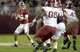 Oct 19, 2013; Tuscaloosa, AL, USA; Alabama Crimson Tide quarterback A.J. McCarron (10) looks to pass against the Arkansas Razorbacks during the first quarter at Bryant-Denny Stadium. Mandatory Credit: John David Mercer-USA TODAY Sports