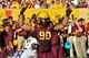 Oct 19, 2013; Tempe, AZ, USA; Arizona State Sun Devils defensive tackle Will Sutton (90) signals to the crowd as Washington Huskies offensive linesman Mike Criste (78) looks on during first half at Sun Devil Stadium. Mandatory Credit: Matt Kartozian-USA TODAY Sports