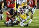 Oct 19, 2013; Oxford, MS, USA; LSU Tigers wide receiver Odell Beckham (3) advances the ball and is tackled by Mississippi Rebels defensive back Cody Prewitt (25) during the game at Vaught-Hemingway Stadium. Mississippi Rebels defeat the LSU Tigers 27-24.  Mandatory Credit: Spruce Derden-USA TODAY Sports