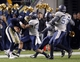 Oct 19, 2013; Pittsburgh, PA, USA; Pittsburgh Panthers quarterback Tom Savage (7) is forced out of bounds by Old Dominion Monarchs linebacker John Darr (46) during the fourth quarter at Heinz Field.  Pittsburgh won 35-24. Mandatory Credit: Charles LeClaire-USA TODAY Sports