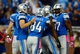Oct 20, 2013; Detroit, MI, USA; Detroit Lions players celebrate after wide receiver Calvin Johnson (not pictured) caught a pass for a touchdown the fourth quarter against the Cincinnati Bengals at Ford Field. Mandatory Credit: Andrew Weber-USA TODAY Sports
