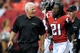 Oct 20, 2013; Atlanta, GA, USA; Atlanta Falcons head coach Mike Smith checks on cornerback Desmond Trufant (21) after an injury against the Tampa Bay Buccaneers during the second half at the Georgia Dome. The Falcons defeated the Buccaneers 31-23.  Mandatory Credit: Dale Zanine-USA TODAY Sports
