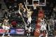 Oct 20, 2013; Atlanta, GA, USA; Memphis Grizzlies center Marc Gasol (33) is fouled by Atlanta Hawks shooting guard Kyle Korver (26) in the third quarter at Philips Arena. Mandatory Credit: Brett Davis-USA TODAY Sports