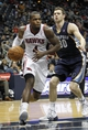 Oct 10, 2013; Atlanta, GA, USA; Atlanta Hawks power forward Paul Millsap (4) drives to the basket against the Memphis Grizzlies in the third quarter at Philips Arena. The Grizzlies defeated the Hawks 90-82. Mandatory Credit: Brett Davis-USA TODAY Sports