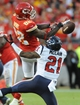 Oct 20, 2013; Kansas City, MO, USA; Houston Texans cornerback Brice McCain (21) breaks up a pass intended for Kansas City Chiefs wide receiver Dwayne Bowe (82) during the second half at Arrowhead Stadium. The Chiefs won 17-16. Mandatory Credit: Denny Medley-USA TODAY Sports