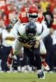 Oct 20, 2013; Kansas City, MO, USA; Kansas City Chiefs outside linebacker Tamba Hali (91) sacks Houston Texans quarterback Case Keenum (7) in the second half at Arrowhead Stadium. The Chiefs won 17-16. Mandatory Credit: John Rieger-USA TODAY Sports