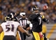 Oct 20, 2013; Pittsburgh, PA, USA; Pittsburgh Steelers quarterback Ben Roethlisberger (7) passes the ball under pressure from the Baltimore Ravens during the fourth quarter at Heinz Field. The Steelers won 19-16. Mandatory Credit: Charles LeClaire-USA TODAY Sports