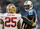 Oct 20, 2013; Nashville, TN, USA; Tennessee Titans wide receiver Kenny Britt (18) and San Francisco 49ers cornerback Tarell Brown (25) exchange words during the second half at LP Field. The 49ers beat the Titans 31-17. Mandatory Credit: Don McPeak-USA TODAY Sports