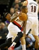 Oct 20, 2013; Portland, OR, USA; Sacramento Kings point guard Isaiah Thomas (22) reacts after Portland Trail Blazers power forward Joel Freeland (19) set a pick for  Blazers point guard Mo Williams (25) in the first half at Moda Center. Mandatory Credit: Jaime Valdez-USA TODAY Sports