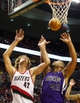 Oct 20, 2013; Portland, OR, USA; Portland Trail Blazers center Robin Lopez (42) and Sacramento Kings power forward Chuck Hayes (42) reach for a rebound in the second half at Moda Center. Mandatory Credit: Jaime Valdez-USA TODAY Sports