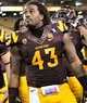 Oct 12, 2013; Tempe, AZ, USA; Arizona State Sun Devils defensive end Davon Coleman (43) on the field after the fourth quarter against the Colorado Buffaloes at Sun Devil Stadium. The Sun Devils beat the Buffaloes 54-13. Mandatory Credit: Casey Sapio-USA TODAY Sports