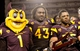 Oct 12, 2013; Tempe, AZ, USA; Arizona State Sun Devils mascot Sparky, defensive end Davon Coleman (43) and running back R.J. Robinson (35) pose for pictures after the fourth quarter against the Colorado Buffaloes at Sun Devil Stadium. The Sun Devils beat the Buffaloes 54-13. Mandatory Credit: Casey Sapio-USA TODAY Sports