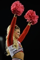 Oct 18, 2013; Louisville, KY, USA; The Louisville Cardinals cheerleaders perform during the second half of play against the UCF Knights at Papa John's Cardinal Stadium. Central Florida defeated Louisville 38-35.  Mandatory Credit: Jamie Rhodes-USA TODAY Sports