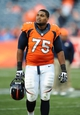 Oct 13, 2013; Denver, CO, USA; Denver Broncos tackle Chris Clark (75) following the game against the Jacksonville Jaguars at Sports Authority Field at Mile High. The Broncos defeated the Jaguars 35-19. Mandatory Credit: Ron Chenoy-USA TODAY Sports