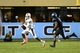 Oct 17, 2013; Chapel Hill, NC, USA; Miami Hurricanes quarterback Stephen Morris (17) looks to pass as North Carolina Tar Heels linebacker Norkeithus Otis (8) defends. The Miami Hurricanes defeated the North Carolina Tar Heels 27-23 at Kenan Memorial Stadium. Mandatory Credit: Bob Donnan-USA TODAY Sports