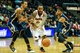 Oct 22, 2013; Atlanta, GA, USA; Atlanta Hawks point guard Jeff Teague (0) drives past Indiana Pacers point guard George Hill (3) and shooting guard Paul George (24) towards the basket in the first half at Philips Arena. Mandatory Credit: Daniel Shirey-USA TODAY Sports