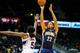 Oct 22, 2013; Atlanta, GA, USA; Indiana Pacers point guard C.J. Watson (32) shoots a basket over Atlanta Hawks small forward DeMarre Carroll (5) in the second half at Philips Arena. The Pacers won 107-89. Mandatory Credit: Daniel Shirey-USA TODAY Sports