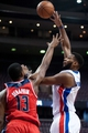 Oct 22, 2013; Auburn Hills, MI, USA; Detroit Pistons center Andre Drummond (0) shoots over Washington Wizards power forward Kevin Seraphin (13) during the fourth quarter at The Palace of Auburn Hills. Pistons won 99-96. Mandatory Credit: Tim Fuller-USA TODAY Sports