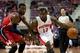 Oct 22, 2013; Auburn Hills, MI, USA; Detroit Pistons point guard Will Bynum (12) drives past Washington Wizards point guard John Wall (2) during the third quarter at The Palace of Auburn Hills. Pistons won 99-96. Mandatory Credit: Tim Fuller-USA TODAY Sports