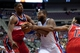 Oct 22, 2013; Auburn Hills, MI, USA; Detroit Pistons center Greg Monroe (10) drives to the basket against Washington Wizards power forward Kevin Seraphin (13) during the fourth quarter at The Palace of Auburn Hills. Pistons won 99-96. Mandatory Credit: Tim Fuller-USA TODAY Sports