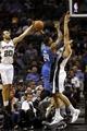 Oct 22, 2013; San Antonio, TX, USA; Orlando Magic forward Romero Osby (24) has his shot blocked by San Antonio Spurs guard Manu Ginobili (20) during the second half at AT&T Center. Mandatory Credit: Soobum Im-USA TODAY Sports