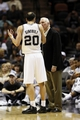 Oct 22, 2013; San Antonio, TX, USA; San Antonio Spurs guard Manu Ginobili (20) talks with head coach Gregg Popovich during the second half against the Orlando Magic at AT&T Center. Mandatory Credit: Soobum Im-USA TODAY Sports
