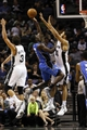 Oct 22, 2013; San Antonio, TX, USA; Orlando Magic guard Victor Oladipo (5) drives to the basket as San Antonio Spurs forward Jeff Ayres (11) defends during the second half at AT&T Center. Mandatory Credit: Soobum Im-USA TODAY Sports